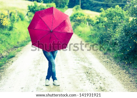 Teenage Girl with Red Umbrella - stock photo