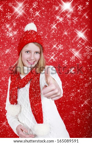 Teenage girl with santa hat and thumbs up