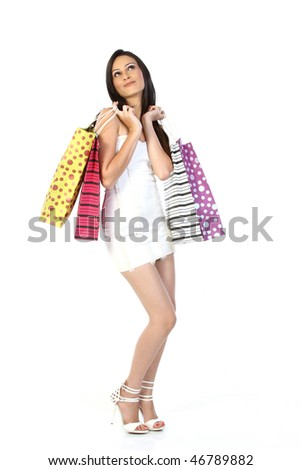 Teenage girl with shopping bags - stock photo