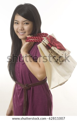 Teenage girl with shopping bags isolated on white - stock photo