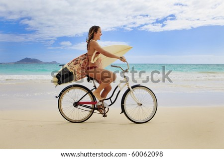 teenage girl with surfboard and bicycle on kailua beach - stock photo