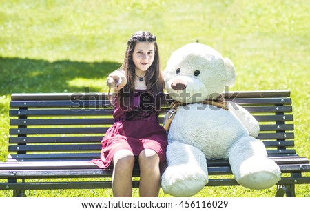 teenage girl with teddy bear