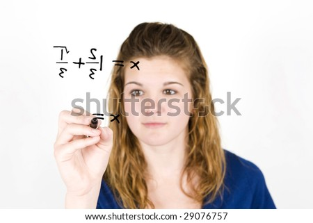 teenage girl writing out a math problem - stock photo