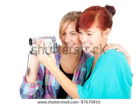 teenage girlfriend with video camera, white background - stock photo