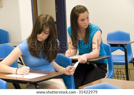 teenage girls cheating on a test