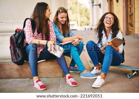 Teenage girls communicating on the street - stock photo