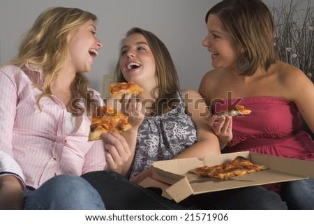Teenage Girls Eating Pizza - stock photo