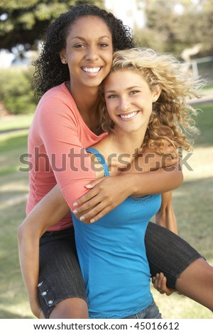 Teenage Girls Having Fun In Park - stock photo