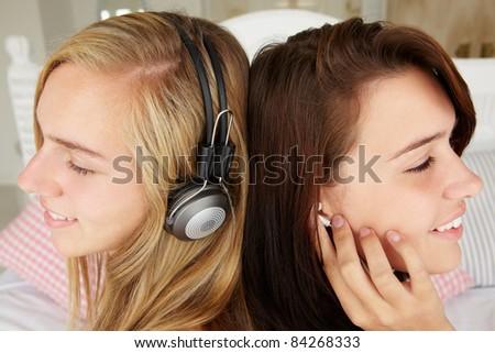 Teenage girls listening to music - stock photo