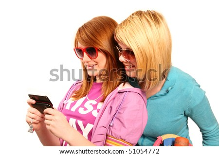 teenage girls looking at mobile isolated on white - stock photo