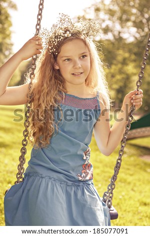 teenage girls on a swing in the park - stock photo