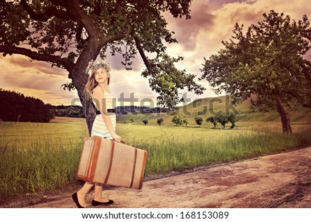 teenage girls on rural road with a case - stock photo