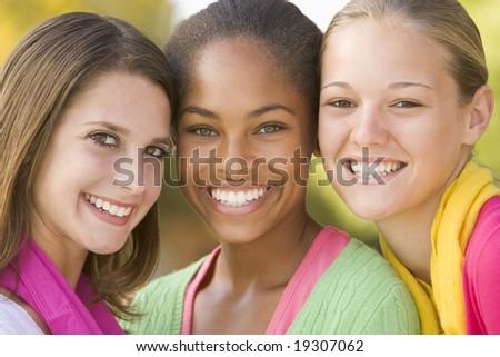 Teenage Girls Outside Smiling - stock photo