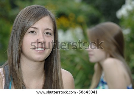 Teenage girls spend some time outside in the garden. - stock photo