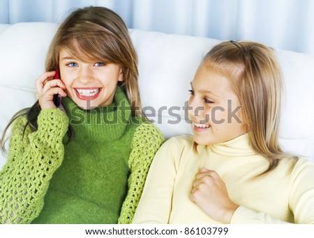 Teenage Girls Talking on Cell Phone - stock photo