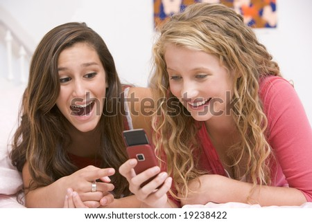 Teenage Girls Texting - stock photo