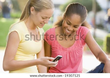 Teenage Girls Texting - stock photo