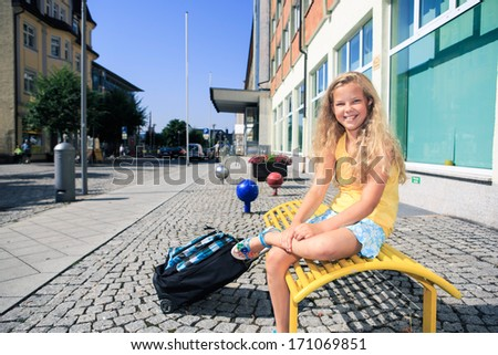 teenage girls waiting for the bus on the way to school in Sonneberg, Germany - stock photo