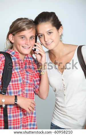 Teenage girls with mobile phone - stock photo