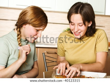 Teenage girls with pizza - stock photo