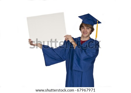 teenage graduate in blue gown smiling and holding a blank sign on white background - stock photo