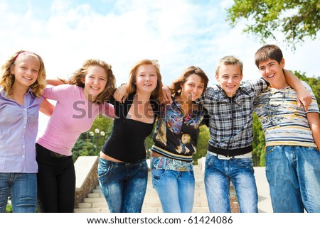 Teenage group embracing - stock photo