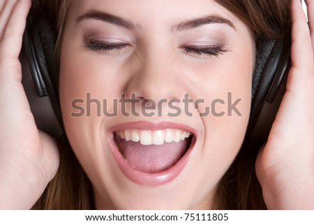 Teenage headphones music girl singing - stock photo