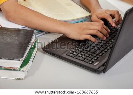 Teenage high school boy studying - stock photo