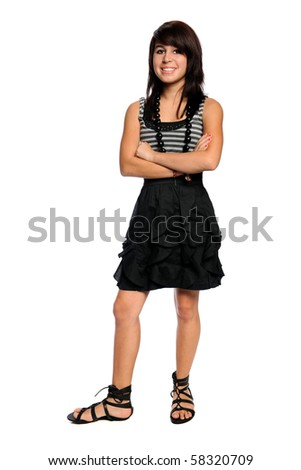 Teenage Hispanic girl standing with arms crossed isolated over white background - stock photo