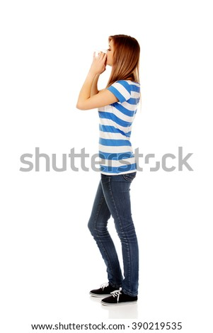 Teenage ill woman using a tissue - stock photo