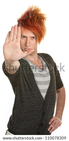 Teenage male in orange mohawk with hand in front