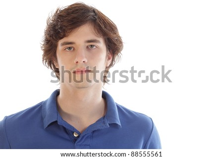 Teenage male looking serious wearing blue golf shirt polo - stock photo