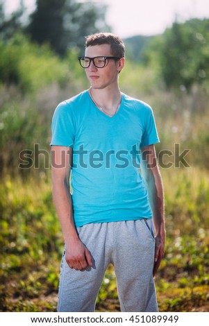 Teenage man enjoy with sunshine in wheat field - stock photo