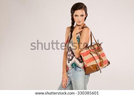 Teenage on gray background shopping - stock photo
