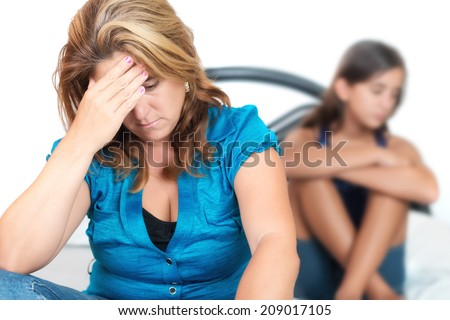 Teenage problems, Worried young mother with her troubled teenage daughter on the background - stock photo