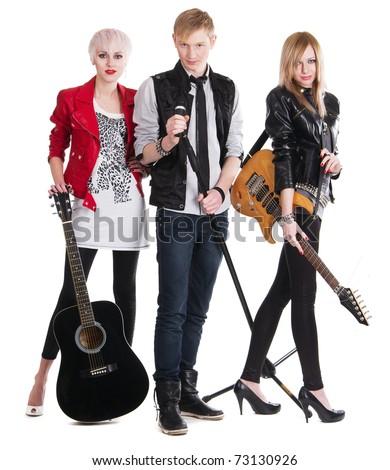 Teenage rock band against white background - stock photo