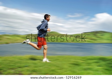 Teenage running in nature - stock photo