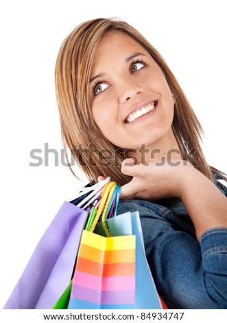 Teenage shopping girl holding bags - isolated over a white background - stock photo