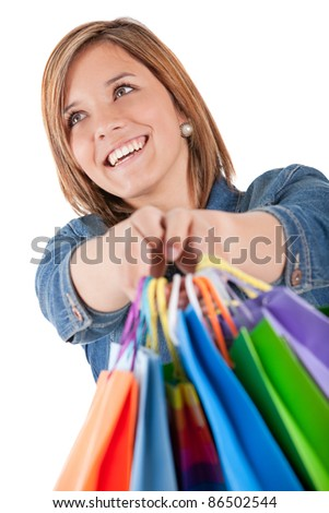 Teenage shopping girl holding bags - isolated over a white background