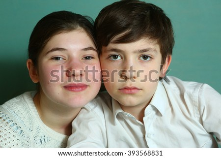 teenage sibling boy and girl close up portrait family similarity - stock photo
