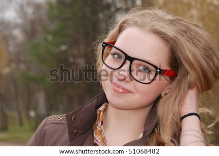 Teenage smiling girl in the spring park - stock photo