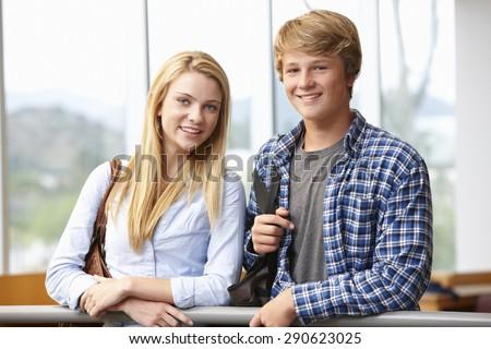 Teenage student girl and boy indoors - stock photo