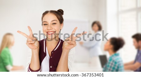 teenage student girl showing peace at school