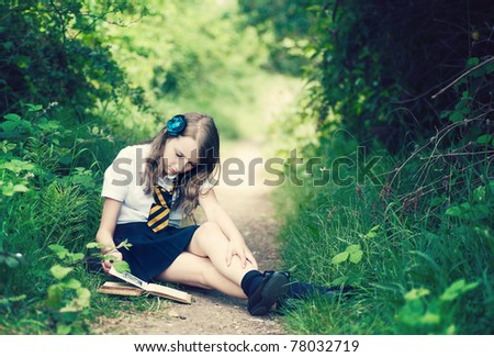 Teenage Student in the park - stock photo