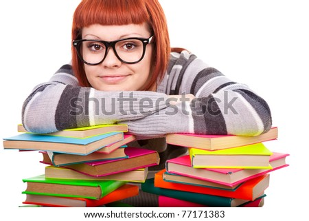 teenage student resting after learning  on a stack of books, isolated on white
