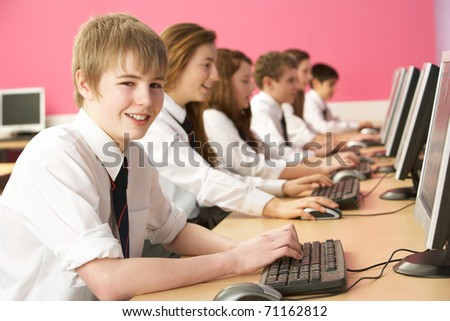 Teenage Students In IT Class Using Computers In Classroom
