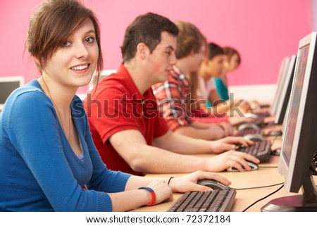 Teenage Students In IT Class Using Computers In Classroom - stock photo