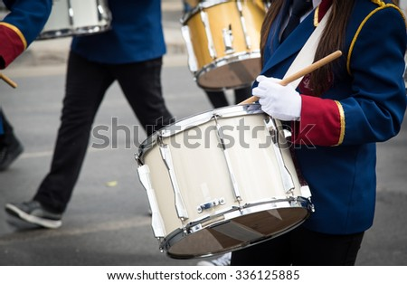 Teenage Students in Uniform playing drums during a parade for the celebrations of ochi day in Nicosia, Cyprus - stock photo