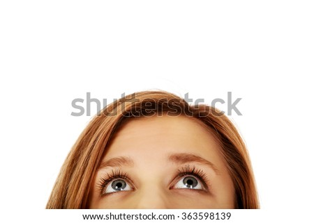 Teenage woman eyes looking up - stock photo