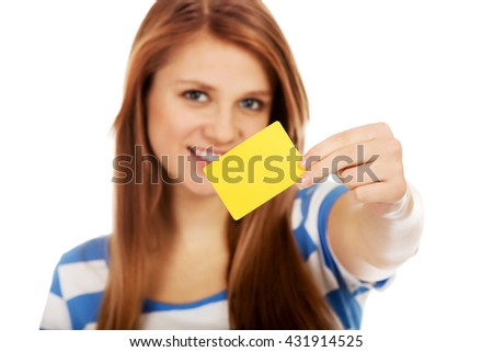 Teenage woman holding empty business card - stock photo